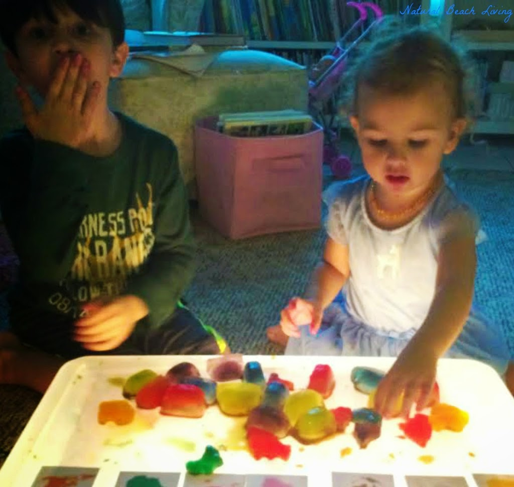 Continents, Montessori Inspired Homemade sensory play with light table and Montessori cards, perfect for Continent study www.naturalbeachliving.com